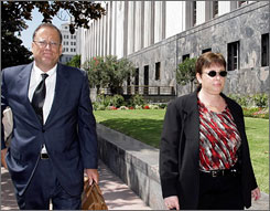Lori Drew, a Missouri women who allegedly perpetrated a MySpace hoax that drove her daughter's 13-year-old classmate to suicide, leaves court Sept. 4 in Los Angeles with her attorney, Dean Steward.