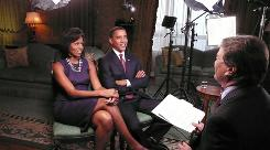 In this Nov. 14, 2008 photo released by CBS, President-elect Barack Obama and Michelle Obama speak with CBS' 60 Minutes reporter Steve Kroft.