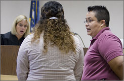 Court interpreter Adriana Hinojosa, right, interprets at a hearing in Douglas County Court before Judge Susan Bazis in Omaha on Sept. 5. Hinojosa is one of 21 certified court interpreters in the state.
