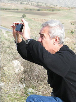 Director Sergei Bodrov surveys the terrain in the mountains of Kurdistan where he explored options of possibly shooting a film there.