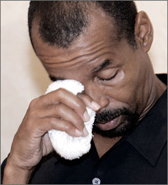 After serving 23 years in prison, Johnny Briscoe wipes tears during a news conference in St. Louis, on July 20, 2006, a day after his release. DNA evidence proved he didn't commit a 1982 rape for which he was serving time.
