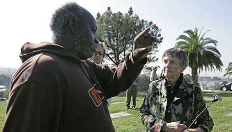 Jonestown survivor Stanley Clayton talks with Clare Bouquet, who lost her son in the 1978 tragedy, during a memorial service in Oakland.