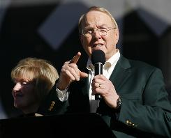 "James Dobson, founder of Focus on the Family, speaks as his wife Shirley looks on during a ""Yes on 8"" anti-gay marriage prayer event held at Qualcomm Stadium in San Diego on Nov. 1."