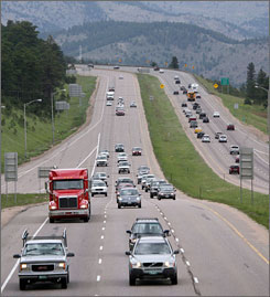 "Traffic flows along on Interstate 70 west of Denver. ""People are changing their driving habits,"" says Jack Finn, senior vice president and national director of toll services for HNTB Corp., a consulting firm based in Kansas City. ""They're taking less trips, there's less driving, more carpooling and part of that lifestyle change will continue."""