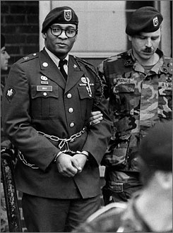 Ronald A. Gray, in handcuffs and chains, is escorted by military police leaving a Fort Bragg, N.C. courtroom in April 1988. President Bush on July 28 approved the execution of the Army private, the first time in over a half-century that a president has affirmed a death sentence for a member of the U.S. military.