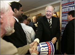 Re-elected Congressman John Murtha, D-Pa., who has represented his district for 34 years, greets supporters at his campaign headquarters in Johnstown, Pa., on Election Day, after a fundraising windfall.