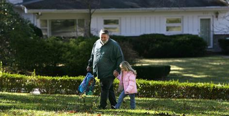 Ron Crabtree walks his granddaughter, Emma Largen,4, home after her preschool in Bluefield.