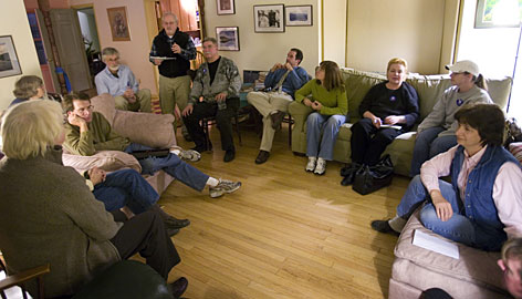 Rob Price, standing, discusses future projects Wednesday at a meeting of Obama backers in Bloomington, Ind.