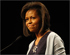 Michelle Obama speaks at the Democratic National Convention women's conference in August. As first lady, she steps into one of the least defined but most scrutinized jobs in Washington.
