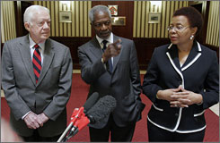 Former U.S. President Jimmy Carter, left, pictured with former UN head Kofi Annan, and Graca Machel, wife of former South African President Nelson Mandela at a news conference in Johannesburg, says he and others have been refused entry to Zimbabwe for a humanitarian mission. Carter says he and other members of The Elders group were informed Friday night by former South African President Thabo Mbeki that efforts to secure travel visas had failed.