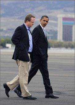 Barack Obama talks with his campaign communications director Robert Gibbs after landing in Reno, Nevada on Sept. 29, 2008. President-elect Obama has named Gibbs as his White House press secretary, Obama's transition office said in a statement on Saturday