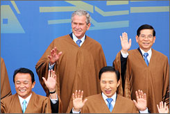 Japanese Prime Minister Taro Aso, left,  U.S. President George W. Bush, South Korean President Lee Myung-bak and Vietnamese President Nguyen Minh Triet pose for the family photo during the Asia-Pacific Economic Cooperation (APEC) summit in Lima on Sunday. The world leaders are wearing traditional Peruvian ponchos.