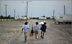 Children walk home in a FEMA trailer park May 22 in Port Sulphur, La.