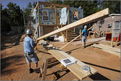 Volunteers finish the trusses for the roof of a Habitat for Humanity home in May in Pascagoula, Miss.