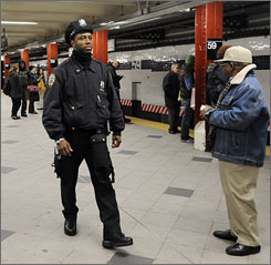 "A New York City Police officer walks a subway platform in midtown on Wednesday. NYPD spokesman Paul Browne said they have received an unsubstantiated report and as a result have ""deployed additional resources in the mass transit system."""