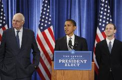 President-elect Barack Obama, flanked by former Federal Reserve Chairman Paul Volcker, chairman-designate of the Economic Recovery Advisory Board, left, and chief economist-designate Austan Goolsbee, speaks during a news conference in Chicago.