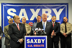 Sen. Saxby Chambliss, R-Ga., and former New York mayor Rudy Giuliani, left, held a news conference on Tuesday, in Cobb County, Ga.