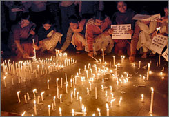 People light candles in Bhopal, India, to pay tribute to the victims of the Mumbai terror attacks.
