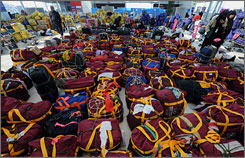 The luggage of stranded pilgrims from southern Thailand sits in the departure lounge of the closed Suvarnabhumi International Airport.
