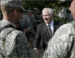 Defense Secretary Robert Gates thanks soldiers after joining them on a foot patrol in October in Gjilan, Kosovo. Gates presided over a shift in deployment strategy that helped turn around the war in Iraq.