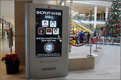 Every six minutes, the mug shots of five convicted shoplifters are shown on 11 digital displays scattered throughout the Staten Island Mall.