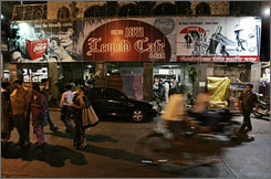 The Leopold Cafe, popular with students, backpackers, tourists and traveling business people, reopened Monday.