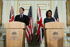 Secretary of State Condoleezza Rice, right, seen here on Monday t a news conference in London with British Foreign Secretary David Miliband, is urging Pakistan to cooperate in the investigation of the Mumbai terror attacks.