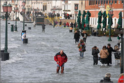 Venice, Italy, is seeing its worst flooding in more than 20 years. Here, people walk along a flooded quay of the Grand Canal on Monday.
