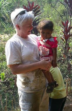 Pam Grignaffini holds a Honduran girl during her 2006 trip to help clean up a schoolhouse.