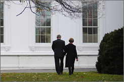 President Bush and first lady Laura Bush, seen here making their way back into the White House after a World AIDS Day statement on Monday, will have a home in Dallas after they leave Washington next month.