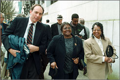 Mayola Williams, center, is seeking a $79.5 million award in her case against cigarette makers that is now before the U.S. Supreme Court. Williams' late husband was a longtime smoker. Here, she is seen in March 1999 in Portland, Ore., with her lawyer and daughter leaving the Multnomah County Courthouse.