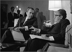 """Seen here in Nov. 1972, President Nixon confers with Henry A. Kissinger in New York after the presidential adviser returned from a week of secret negotiations in Paris with North Vietnam's Le Duc Tho. """"We're going to bomb them,"""" Nixon told Kissinger and adviser Alexander Haig, four days before green lighting a massive bombing campaign on Hanoi and Haiphong during the war in Vietnam."""