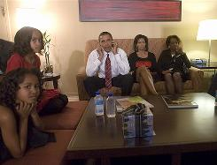 Barack Obama and his family, including mother-in-law Marian Robinson, right, watch Election Night results in Chicago.
