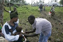 A health worker vaccinates a child against measles in a camp for displaced people Nov. 16 in Kibati, Congo.