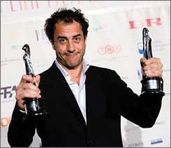 Italian director Matteo Garrone displays  the European Director Award and the European Film Award for the movie 'Gomorra', during the European Film Award 2008 ceremony Saturday, in Copenhagen, Denmark.