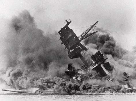 This year's observances in recognition of the Japanese bombing of Pearl Harbor will be a departure from the usual program, and will include a focus on the response to the attack. Here, the U.S.S. Arizona topples into the sea after the Dec. 7, 1941, attack.