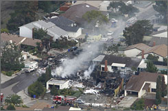 Smoke rises from a fire after an F-18 military jet crashed into a suburban neighborhood in San Diego.