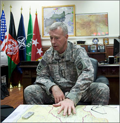 Gen. McKiernan sits in his office at ISAF headquarters in Kabul. &quot;I don't like to use the word 'surge' here because if we put these additional forces in here, it's going to be for the next few years,&quot; he said. &quot;It's not a temporary increase of combat strength.&quot;