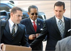 Jackson (Miss.) Mayor Frank Melton, center, and his attorneys arrive at federal court last month on charges related to a raid on an alleged crack house