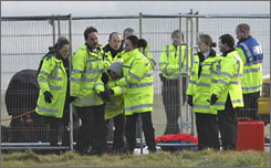 Some 50 demonstrators against global warming broke into a secure area of Stansted Airport near London Monday, police said.