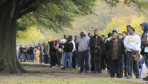 Voters line up outside Rosemont Middle School in Norfolk, Va., on Election Day. African-American voters reported waiting for an average of 29 minutes to vote on Nov. 4, compared with an average wait of 13 minutes for others.