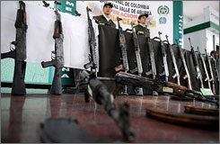 U.S., Mexican and Columbian officials are taking new steps to stop U.S.-based gun-smuggling networks that arm violent Mexican drug cartels with guns, like these seized AK-47 assault rifles seen here.