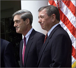 The U.S. Supreme Court has offered no clear indication that it intends to remove former FBI chief Robert Mueller, left, or former Attorney General John Ashcroft, right, from a lawsuit alleging abuse of prisoners detained in the wake of the Sept. 11 attacks. Here, the two are seen in a ceremony at the White House in July 2001.