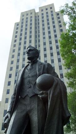 "A statue of ""Honest John"" Burke, governor from 1907 to 1913, stands in front of the North Dakota's state capitol building in Bismarck. North Dakota had the highest rate of public corruption convictions won by federal prosecutors from 1998 through 2007."