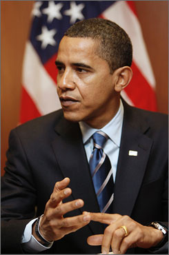 President-elect Barack Obama, seen here meeting with reporters in Chicago on Tuesday, says he wants to boost the image of America among Muslims.