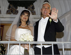 Florida Gov. Charlie Crist, right, and his new bride Carole meet the media after their wedding on Friday, in St. Petersburg, Fla.
