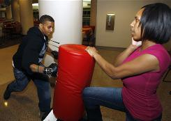 "Transfer student Jamar Simon hits a punching bag at a ""Stress Blowoff"" event at the student union on the University of Missouri-St. Louis campus, where more than 75% of the 12,500 undergraduate students started their education somewhere else."