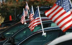 American flags adorn cars for sale at Santa Rosa Chevrolet Friday in Santa Rosa, Calif. Auto dealerships continue to see a sharp decline in sales as the Big Three U.S. automakers face possible bankruptcy.