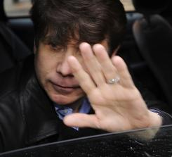 Illinois Gov. Rod Blagojevich leaves a downtown meeting with a high-profile defense attorney Saturday.