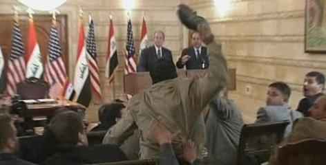 A shoe-thrower interrupted a news conference held Thursday by President Bush and Iraqi Prime Minister Nouri al-Maliki. Bush ducked to avoid the man's shoes.